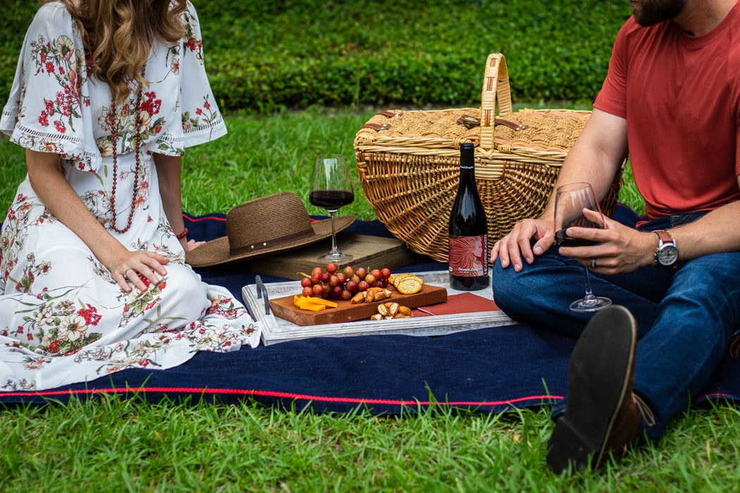 A man and woman having a picnic.