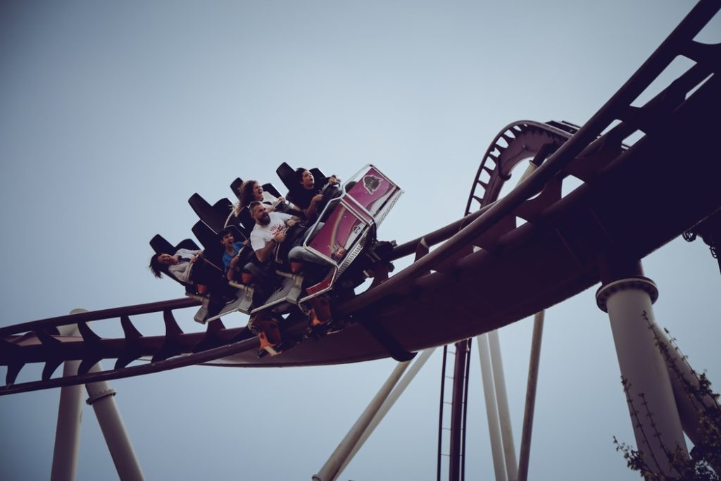People riding on a roller coaster.